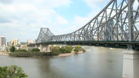 engineered : Timelapse of Story Bridge in Brisbane Queensland Australia with boats and city cats.