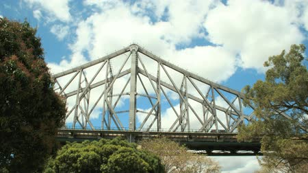 engineered : Timelapse of clouds with the Story Bridge in the foreground in Brisbane Queensland Australia.