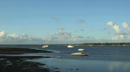 cascos : Timelapse zoom back from boats on the water at Pumicestone Passage on Bribie Island Queensland Australia