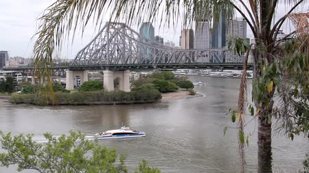 engineered : BRISBANE, AUSTRALIA - SEPTEMBER 28 2011: The iconic Story Bridge spanning the Brisbane River in Brisbane Australia with a city cat ferry. Construction of the bridge began on May 24 1935 and has now become Brisbanes greatest tourist attraction.