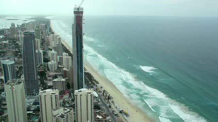 premier : SURFERS PARADISE, AUSTRALIA - OCTOBER 5 2011: Aerial view of iconic Surfers Paradise. Surfers Paradise is Australias premier tourist destination and its most popular beach city. It was established by Jim Cavill in 1920 when he acquired 25 acres of land o