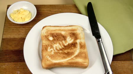 eye piece : Breakfast setting being made up with a piece of toast with a smile engraved in it.