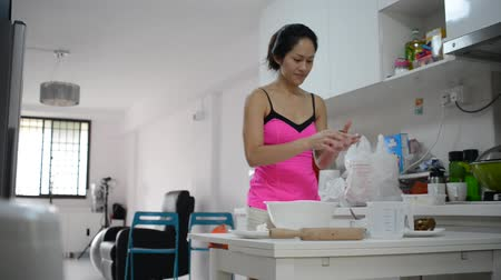 cooks : Asian chinese woman preparing and cooking Stock Footage