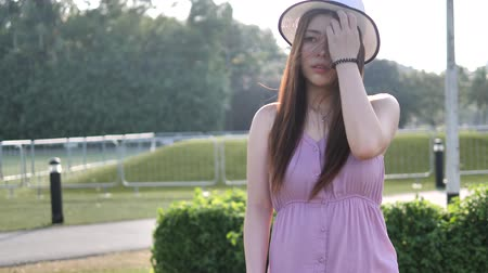 шале : Asian chinese woman in slow motion walking on grass lawn