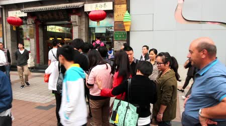 populární : Lots of visitors in queue outside the tea shop for the icecream in Beijing, China