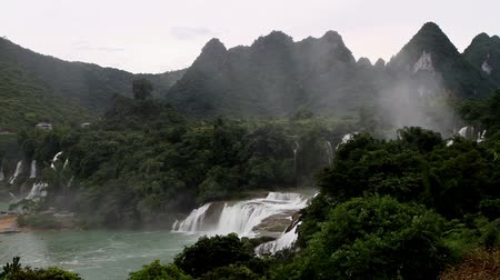 guangxi : Detian Waterfall and the mountains in Guangxi, China Stock Footage