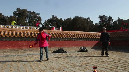 cold : Beijing,China-Feb 2, 2014: The old man and woman play diabolo together at temple fair during Chinese Spring Festival in Beijing, China