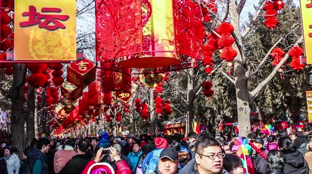 ditan : Beijing,China-Feb 2, 2014: Thousands of people visit temple fair in Ditan Park during Chinese Spring Festival in Beijing, China1