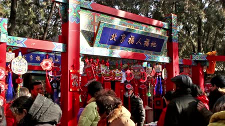 ditan : Beijing,China-Feb 2, 2014: The customers choose decorated stuff at temple fair in Ditan Park during Chinese Spring Festival in Beijing, China7