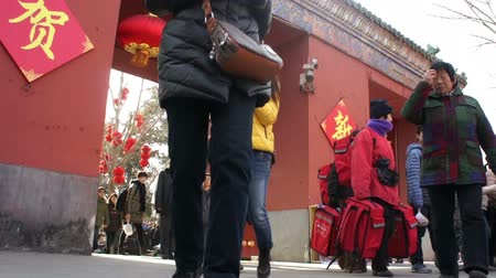 ditan : Beijing,China-Feb 2, 2014: In the cold, people still go out for temple fair in Ditan Park during Chinese Spring Festival in Beijing, China
