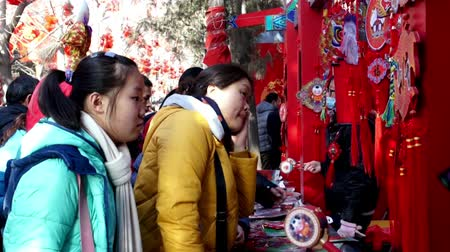 ditan : Beijing,China-Feb 2, 2014: People play games for winning gifts at temple fair in Ditan Park during Chinese Spring Festival in Beijing, China