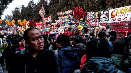 ditan : Beijing,China-Feb 6, 2014: Variety of toy stands and the visitors at Ditan temple fair during Spring Festival in Beijing, China