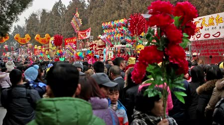 ditan : Beijing,China-Feb 6, 2014: The colorful toy stand and the visitors at Ditan temple fair during Spring Festival in Beijing, China