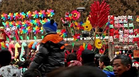 ditan : Beijing,China-Feb 6, 2014: Different toy stands and the visitors at Ditan temple fair during Spring Festival in Beijing, China Stock Footage