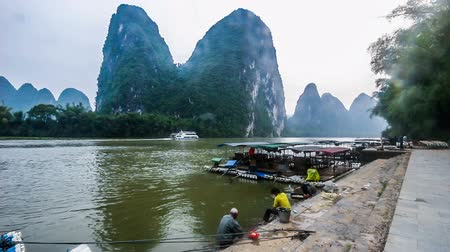 guangxi : Yangshuo,China-Apr 28,2014:The local people do washing in Li river,Yangshuo,Guangxi,China Stock Footage