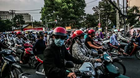 pole street : Ho chi minh city,Vietnam-April 10,2014:The street is full of motorbikes in the rush hour, ho chi minh city, Vietnam Stock Footage