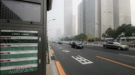 автобус : Beijing,China-Oct 25,2014: In the bad weather,the Bus stop and the traffic at Changan Avenue, Beijing, China Стоковые видеозаписи