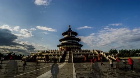 imparator : Walking from right to left,the Qinian Hall and visitors in the Heaven of Temple park of Beijing, China.