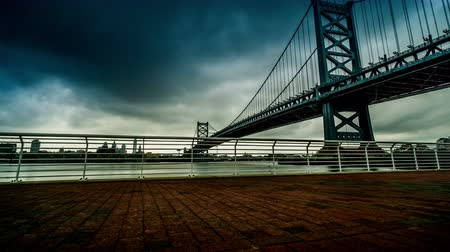 solo : Under cloudy sky,the Benjamin Franklin Bridge and pedestrian road, Philadelphia, USA