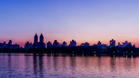 outline : At evening, the Manhattan skyline, New York City, NY