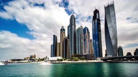 cayan tower : Timelapse of clouds floating above Dubai Marina(Cayan Tower), UAE