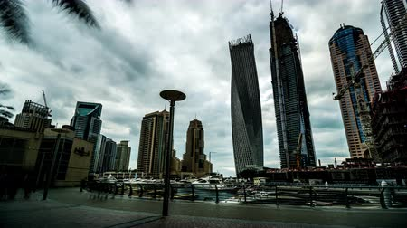 cayan tower : Timelapse of the visitors wander at Dubai Marina(Cayan Tower), UAE