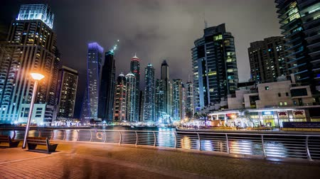 cayan tower : Timelapse of the visitors wander along Dubai Marina(Cayan Tower) at night, UAE Stock Footage