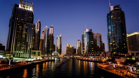 pleasure boats : From dusk to night, the ships and modern buildings in the Dubai Marina, UAE Stock Footage