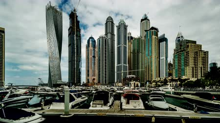 cayan tower : Timelapse of Modern buildings and yachts in Dubai Marina, UAE