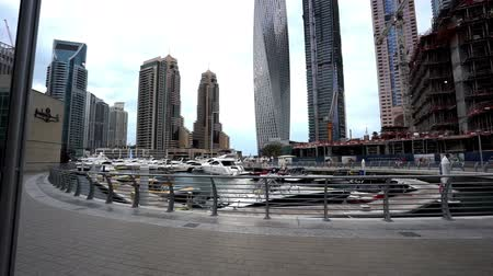 cayan tower : Walking towards Dubai Marina(Cayan Tower), UAE Stock Footage