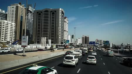 busy line : Fast forward of the modern cityscape view by bus in Dubai, UAE