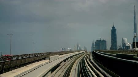 khalifa : Modern cityscape view by metro in Dubai, UAE Stock Footage