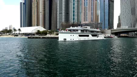 cayan tower : The private yacht moving slowly in Dubai Marina, UAE
