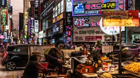 продавец : At night, the customers walking in the shopping street, Busan, Korea