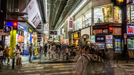 crossing road : Timelapse of the fashion young people shopping at Shinsaibashi street, Osaka, Japan Stock Footage