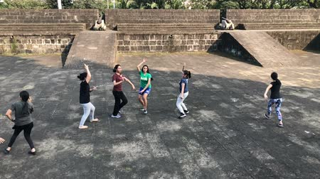 manilla : slow motion-Young women dancing in group on the ancient citywall, Manila, Philippines