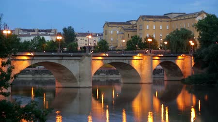 reflexão : Old bridge (Puente da Piedra) over Ebro river in evening. Logrono, Spain