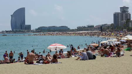 pokoj : BARCELONA, SPAIN - JULY 15, 2014: Barceloneta Beach and Hotel Vela in summer. Barcelona, Spain.  Barceloneta Beach - one of the most popular in the city
