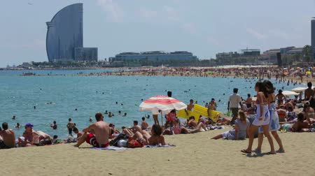 pokoj : BARCELONA, SPAIN - JULY 15, 2014: Barceloneta Beach and Hotel Vela in summer. Barcelona, Spain.  It is one of the most popular in the city Wideo