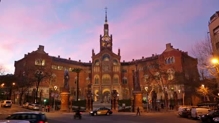 Каталония : BARCELONA, SPAIN - MARCH 3, 2015: View of Barcelona, Spain. Hospital de la Santa Creu i Sant Pau in evening Стоковые видеозаписи