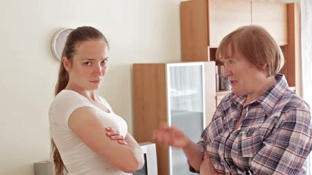 conflict : Mother and adult daughter having quarrel in home Stock Footage