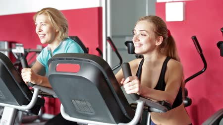 различный : Women of different age training on exercise bikes together Стоковые видеозаписи