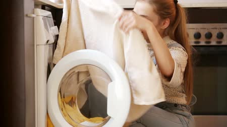 smell : Upset girl looking at stains on towels after laundry Stock Footage