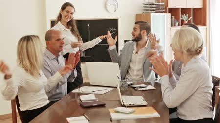 agreement : Smiling business people during conference call indoors