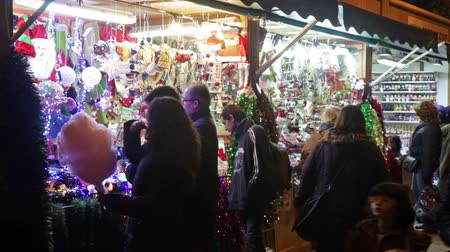 disambiguation : BARCELONA, SPAIN - NOVEMBER 30, 2015: Traditional Christmas toys and gifts at stand  in evening. Barcelona, Catalonia. Christmas market near Sagrada Familia
