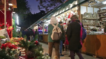 disambiguation : BARCELONA, SPAIN - NOVEMBER 30, 2015: Traditional Christmas market near Sagrada Familia church in evening. Barcelona, Catalonia.