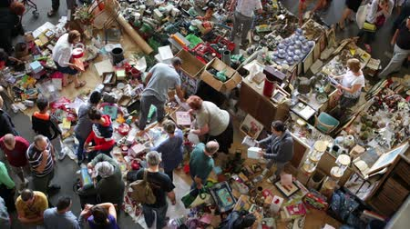 jumble : BARCELONA, SPAIN - OCTOBER 8, 2016: Top view of flea market in Barcelona, Spain. Encants Vells is one of the oldest markets in Europe, has been known since the 14th century