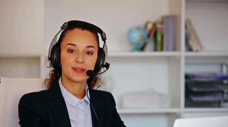 merkez : Cheerful girl with headset and laptop answering call in office
