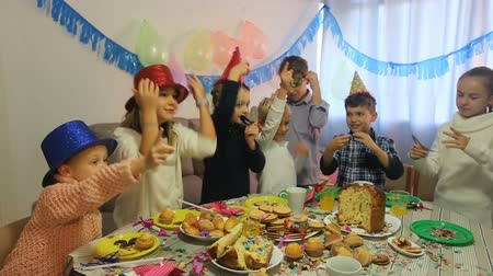 шляпа : Boys and girls behaving jokingly during friends birthday party