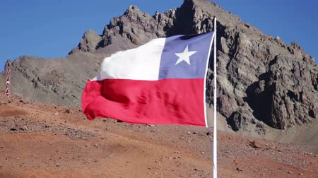 директор : National flag of Chile waving in the strong wind in blue sky
